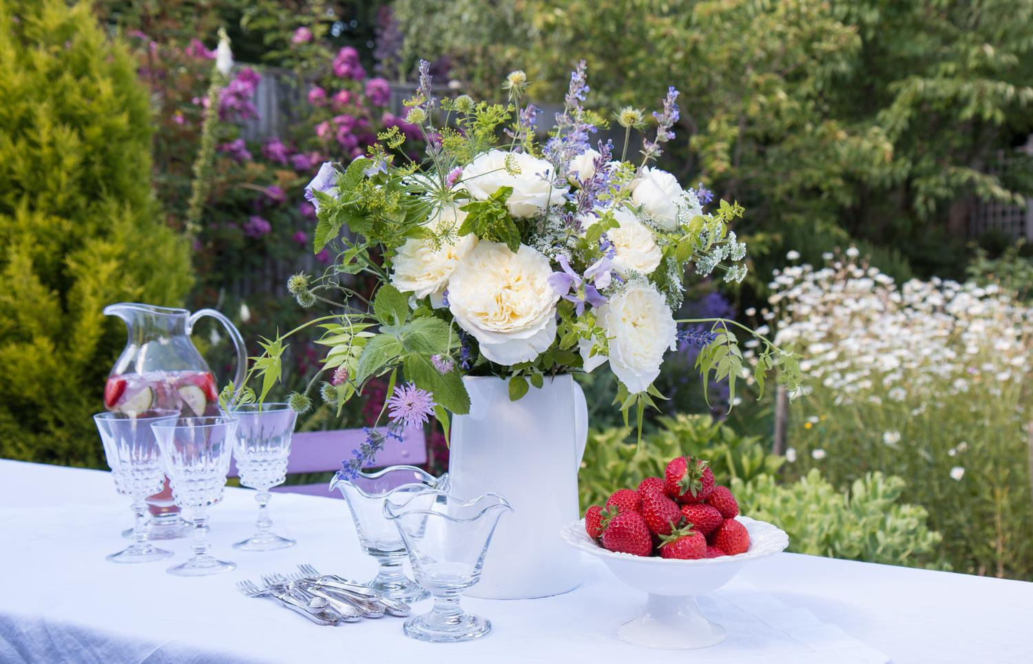 Summer Outdoors Party With Cream Roses Strawberries and Champagne