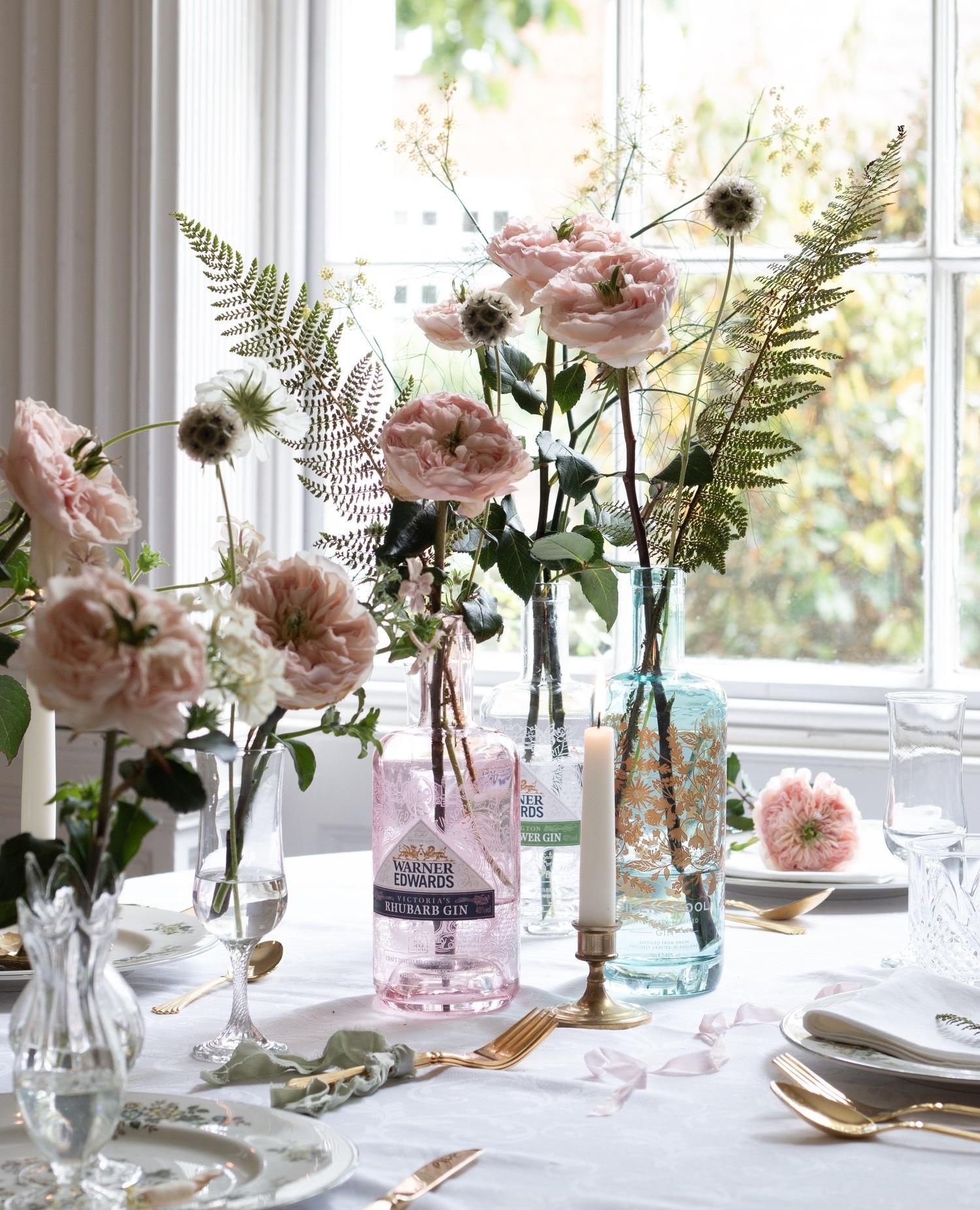 Charity Blush Roses in Gin Bottle Vases