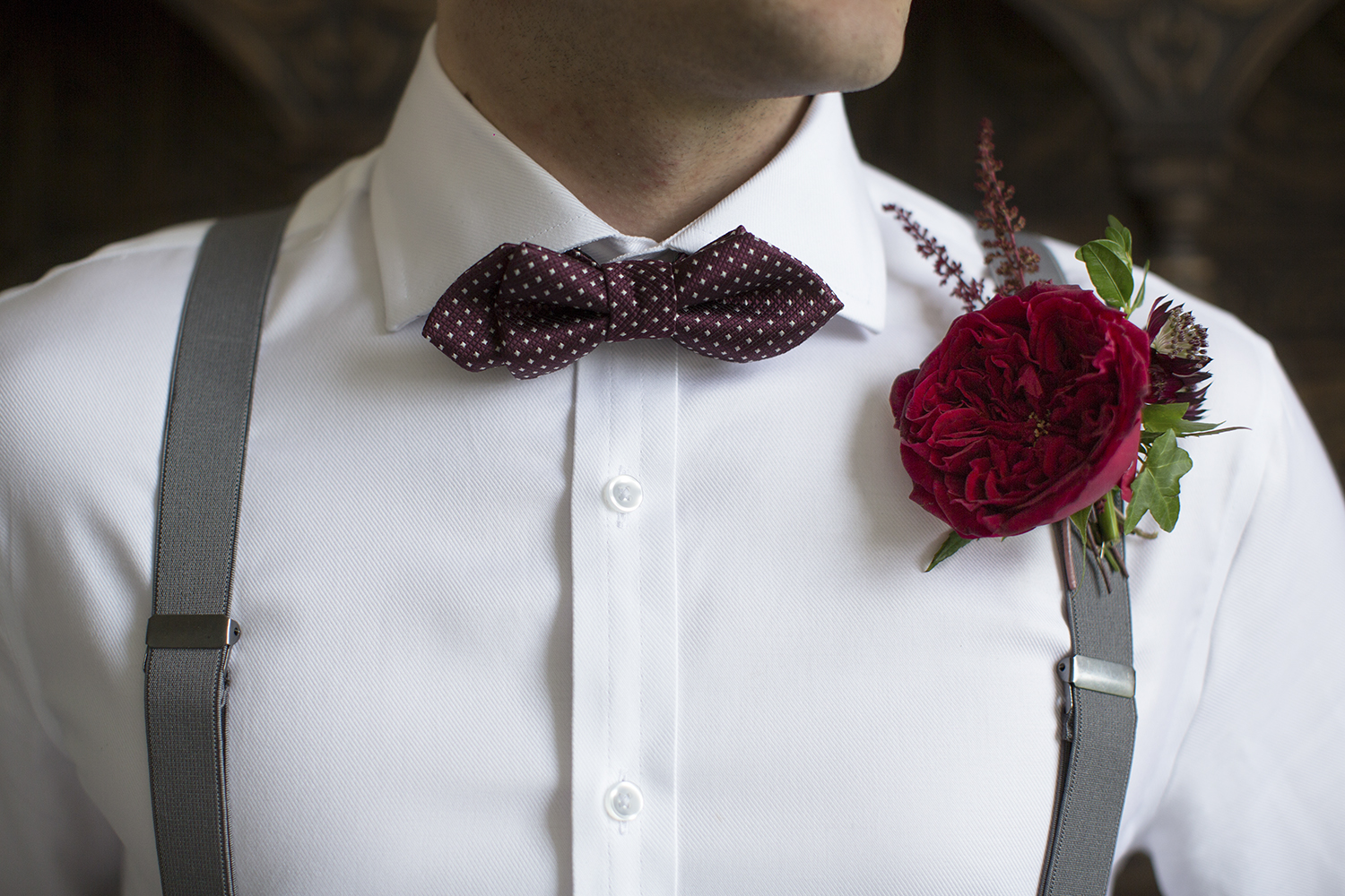 Tess red roses groom buttonhole
