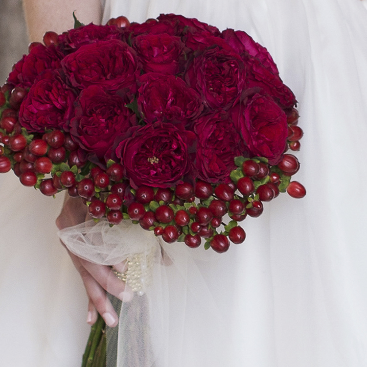 Tess red roses hand held bouquet