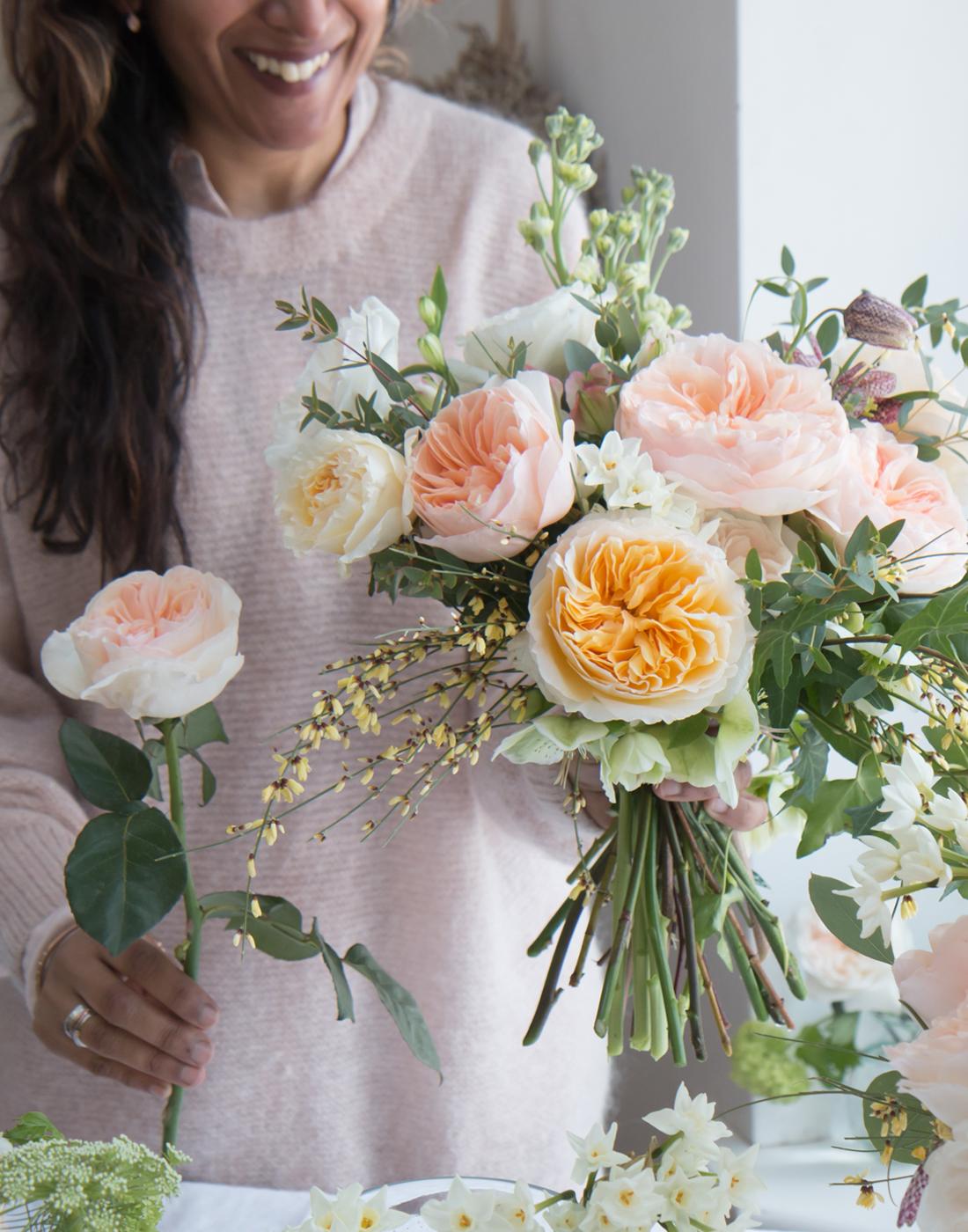Florist creating spring bouquet using David Austin cut roses