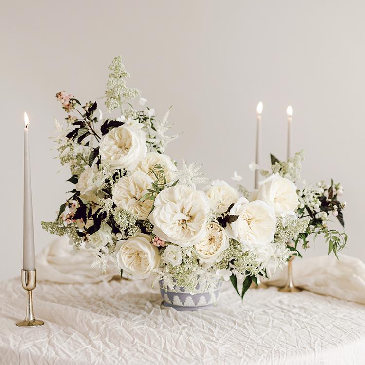 Leonora white roses vase arrangement wedding event