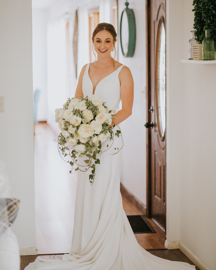 Bride Holding Bouquet of White Leonora Roses