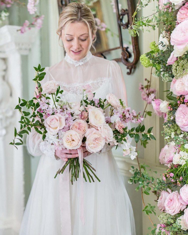 Bride Holding Wedding Bouquet David Austin Pink Roses
