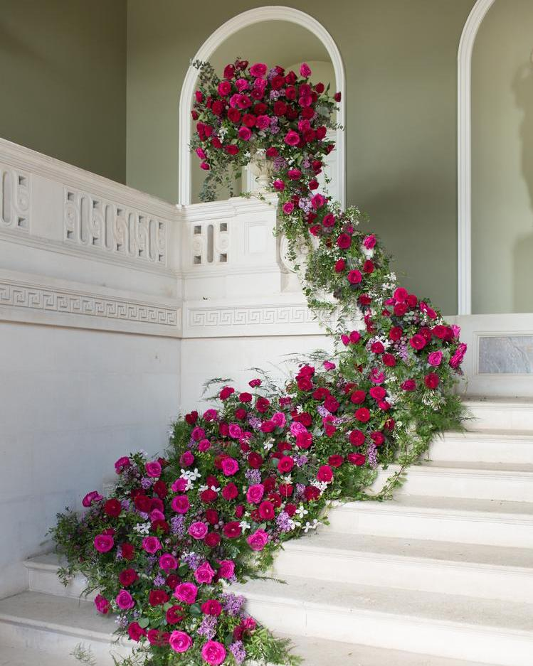 Cascading Roses Down Staircase at Luxury Wedding Venue